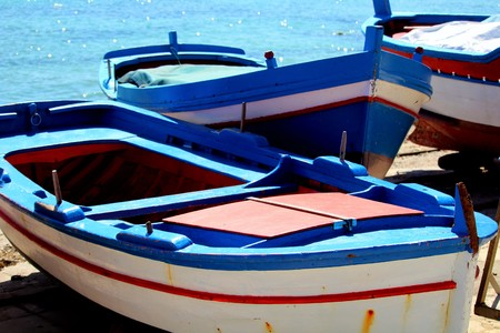 cute fishing boats in Sicily, Italy with blue sky and sea
