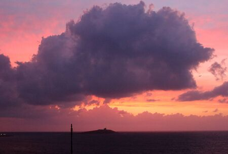 evocative image of sunset over the sea with island in the background Archivio Fotografico - 127174474