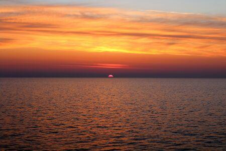 evocative image of sunrise over the sea with sun rising over the horizon Archivio Fotografico - 127175554