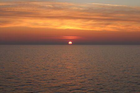 evocative image of sunrise over the sea with sun rising over the horizon Archivio Fotografico - 127175568