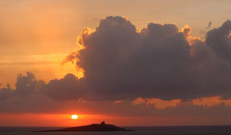 evocative image of sunset over the sea with cloud in the foreground Archivio Fotografico - 127175603