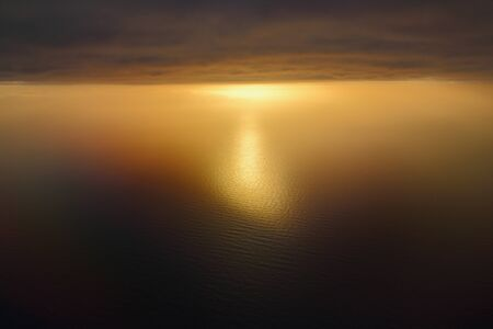 evocative image of sunset over the sea with clouds in the background Archivio Fotografico - 127175713