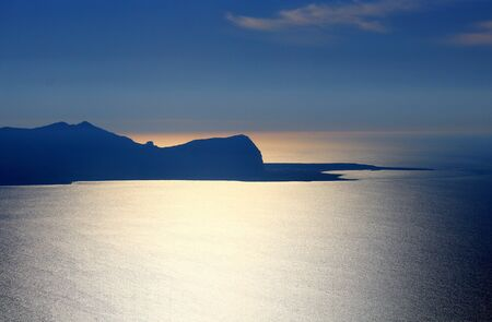 evocative image of the coast at sunset in Sicily, Italy Archivio Fotografico - 127175747