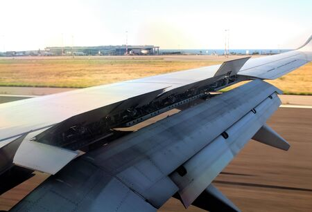 interesting image of the wing of a 737 aircraft during the landing phase with the flaps open