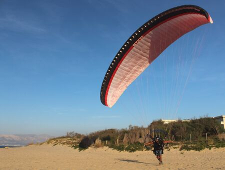 interesting image of paragliding sail with petrol engine and propeller with protection during take-off