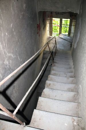 2019.06.16 - Limbiate, Milan, Italy, photographic reportage madhouse in Mombello, abandoned psychiatric hospital service stairs with handrail for access to abandoned floors