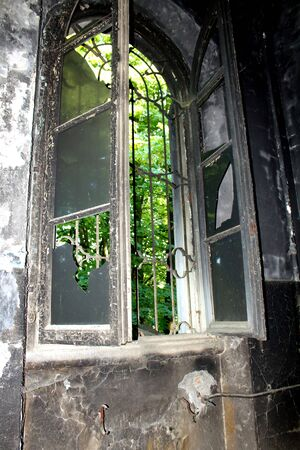 2019.06.16 - Limbiate, Milan, Italy, photographic reportage madhouse in Mombello, abandoned psychiatric hospital hospital window with broken glass and shutters and grating