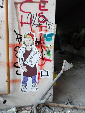 2019.09.28 - Limbiate, Milan, Italy, photo reportage asylum in Mombello, abandoned psychiatric hospital murals on the wall of a corridor of the hospital structure