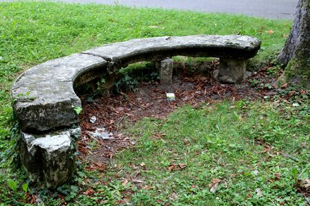 2019.09.28 - Limbiate, Milan, Italy, photographic reportage asylum in Mombello, abandoned psychiatric hospital, stone bench in the shape of a semicircle in the garden