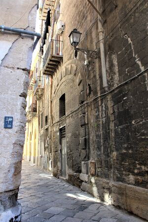 evocative image of an ancient street in the historic center of Palermo in Italy