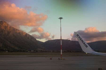 2020.02.20 Palermo Punta Raisi, Ryanair plane taking off with mountains and clouds in the background at sunset