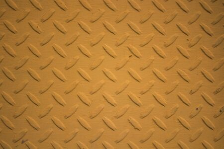 evocative image of metal plate texture with abstract relief patterns