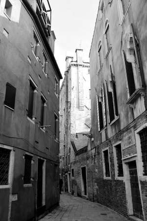 Venice, Italy, December 28, 2018 evocative image of the narrow calle of Venice