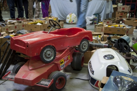 means of transportation: old toy cars with pedals Editorial