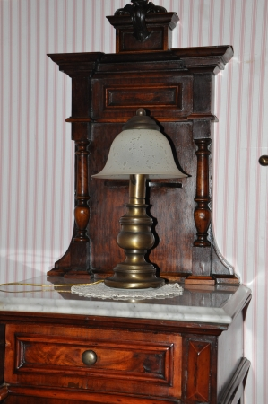 antique lamp on the bedside table photo