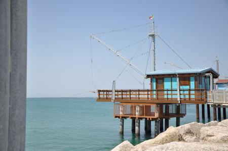 stilts: Fisherman house on wooden stilts in Fano