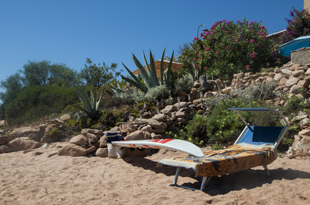 serf: beach with deckchairs and serf