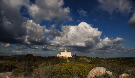 tolerate: overview of the lighthouse resort  'Head Lighthouse in Sardinia Italy Stock Photo