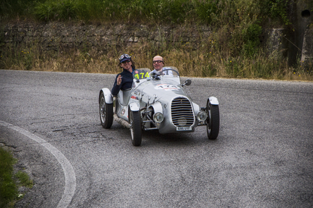 miles: PESARO, ITALY - MAY 15: BENEDETTI Giannini 750 Sport 1948 Race car vintage one thousand miles in 2015 on an old racing car in rally Mille Miglia 2015 the famous historical italian race (1927-1957) on May 2015