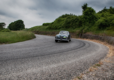 miles: PESARO, ITALY - MAY 15: ALFA ROMEO 1900 C Sprint Race Pininfarina 1953 vintage car one thousand miles in 2015 on an old racing car in rally Mille Miglia 2015 the famous historical italian race (1927-1957) on May 2015