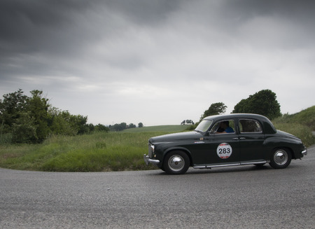 miles: PESARO, ITALY - MAY 15: ROVER 75 1953 Race car vintage one thousand miles in 2015 on an old racing car in rally Mille Miglia 2015 the famous historical italian race (1927-1957) on May 2015 Editorial