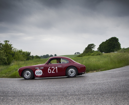 miles: PESARO, ITALY - MAY 15: CISITALIA 202 D 2800 cc 1952 Race car vintage one thousand miles in 2015 on an old racing car in rally Mille Miglia 2015 the famous historical italian race (1927-1957) on May 2015 Editorial