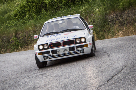 miles: PESARO, ITALY - MAY 15: Lancia delta hf one thousand miles in 2015 on an old racing car in rally Mille Miglia 2015 the famous historical italian race (1927-1957) on May 2015