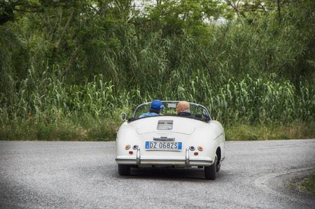 speedster: PESARO, ITALY - MAY 15: PORSCHE 356 Speedster 1500 1955 Race car vintage one thousand miles in 2015 on an old racing car in rally Mille Miglia 2015 the famous historical italian race (1927-1957) on May 2015 Editorial