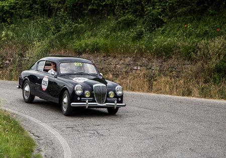 farina: PESARO, ITALY - MAY 15: 2000 Lancia Aurelia B20 GT Berlinetta Pinin Farina 1951 old racing car in rally Mille Miglia 2015 the famous historical italian race (1927-1957) on May 2015