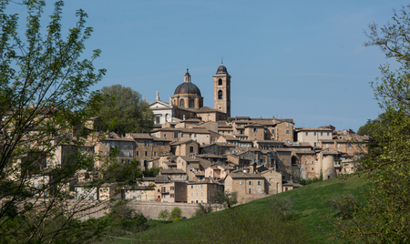 Urbino, Italy - April 10, 2017: view of skyline with Ducal Palace in Urbino Italy. The historic center of Urbino was declared a Unesco World Heritage site and Represents the zenith of Renaissance art and architecture