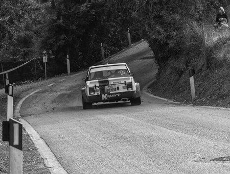 SANMARINO, SANMARINO - OCT 21 - 2017: FIAT 131 ABARTH 1977 old racing car ralts THE LEGEND 2017 the famous SAN MARINO historical race