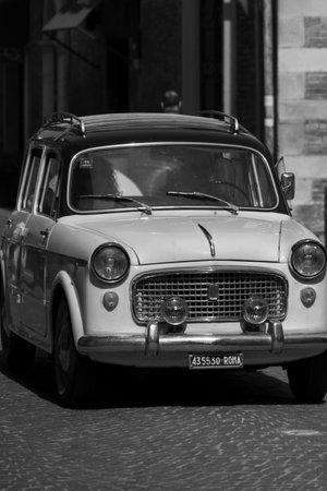 PESARO, ITALY - APRIL 28 - 2018: FIAT 1100 FAMILIAR on an old racing car in the rally RAID ADRIATICO 2018 the famous italian historical race on APRIL 2018 Sajtókép