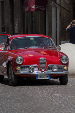 PESARO, ITALY - APRIL 28 - 2018: ALFA ROMEO GIULIETTA on an old racing car in rally RAID ADRIATICO 2018 the famous italian historical race on APRIL 2018 Sajtókép