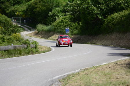 PESARO COLLE SAN BARTOLO, ITALY - MAY 17 - 2018: ABARTH FIAT 750 GT ZAGATO 1957 on an old racing car in the Mille Miglia rally 2018 the famous italian historical race (1927-1957)