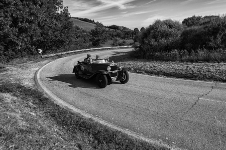PESARO COLLE SAN BARTOLO, ITALY - MAY 17 - 2018: OM 665 S SUPERBA 2000 1929 old racing car in the Mille Miglia rally 2018 the famous italian historical race (1927-1957)