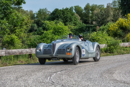 PESARO COLLE SAN BARTOLO, ITALY - MAY 17 - 2018: ALFA ROMEO 6C 2500 SS SPIDER COLLI 1947 old racing car in the Mille Miglia rally 2018 the famous italian historical race (1927-1957)