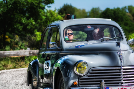 PESARO COLLE SAN BARTOLO, ITALY - MAY 17 - 2018: PEUGEOT 203 1954 old racing car in rally Mille Miglia 2018 the famous italian historical race (1927-1957)