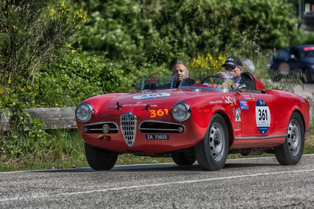 PESARO COLLE SAN BARTOLO, ITALY - MAY 17 - 2018: ALFA ROMEO GIULIETTA SEBRING 1956 old racing car in the Mille Miglia rally 2018 the famous italian historical race (1927-1957)