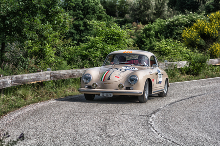 PESARO COLLE SAN BARTOLO, ITALY - MAY 17 - 2018: PORSCHE 356 AT 1500 GS CARRERA 1956 on an old racing car in the Mille Miglia rally 2018 the famous italian historical race (1927-1957)