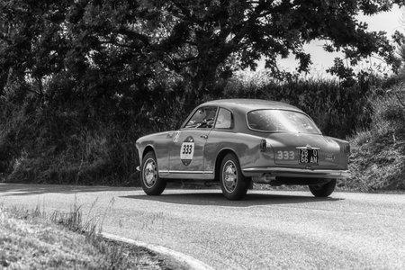 PESARO COLLE SAN BARTOLO, ITALY - MAY 17 - 2018: ALFA ROMEO GIULIETTA SPRINT BERTONE PIERO PELU on an old rally car Mille Miglia 2018 the famous italian historical race (1927-1957)