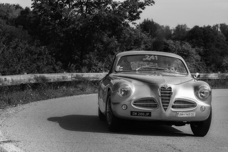 PESARO COLLE SAN BARTOLO, ITALY - MAY 17 - 2018: ALFA ROMEO 1900 C SPRINT TOURING 1952 old racing car in rally Mille Miglia 2018 the famous italian historical race (1927-1957)