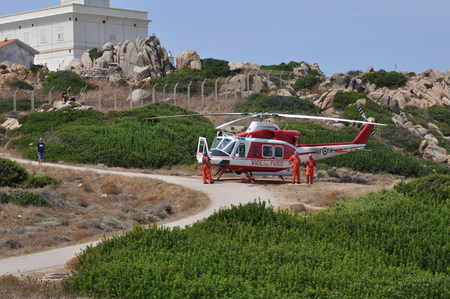 Sardinia Italy - Capo Testa August 22 2018: Helicopter of Italian firefighters Archivio Fotografico - 107889943