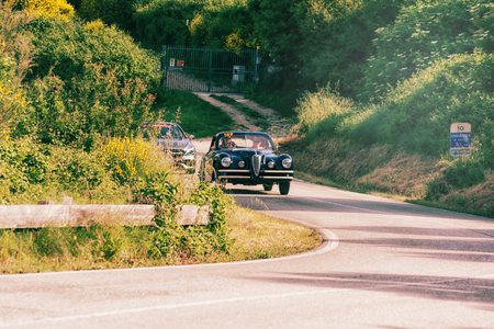 PESARO COLLE SAN BARTOLO, ITALY - MAY 17 - 2018: ALFA ROMEO 6C 2500 SS COUPE TOURING 1949 on an old racing car in the Mille Miglia rally 2018 the famous italian historical race (1927-1957) Editorial