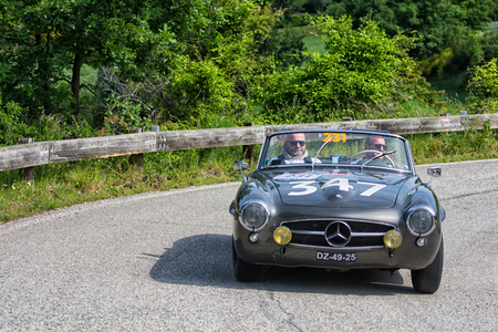 PESARO COLLE SAN BARTOLO, ITALY - MAY 17 - 2018: MERCEDES-BENZ 190 SL 1957 on an old racing car in the Mille Miglia rally 2018 the famous italian historical race (1927-1957)