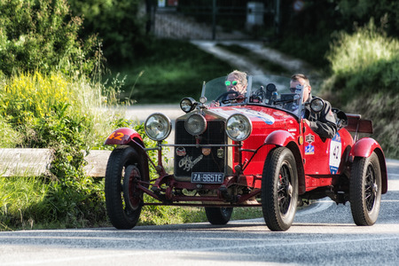 PESARO COLLE SAN BARTOLO, ITALY - MAY 17 - 2018: ALFA ROMEO 6C 1500 SUPER SPORT 1928 MM on an old racing car in the Mille Miglia rally 2018 the famous italian historical race (1927-1957) Editorial