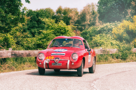 PESARO COLLE SAN BARTOLO , ITALY - MAY 17 - 2018 : ABARTH FIAT 750 GT ZAGATO 1957 on an old racing car in rally Mille Miglia 2018 the famous italian historical race (1927-1957)