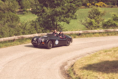 PESARO COLLE SAN BARTOLO , ITALY - MAY 17 - 2018 : JAGUAR XK 120 OTS 1950 on an old racing car in rally Mille Miglia 2018 the famous italian historical race (1927-1957)