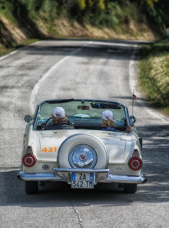 PESARO COLLE SAN BARTOLO, ITALY - MAY 17 - 2018: FORD THUNDERBIRD 1956 on an old racing car in rally Mille Miglia 2018 the famous italian historical race (1927-1957)