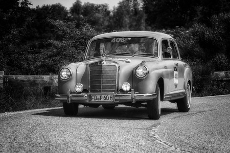 PESARO COLLE SAN BARTOLO, ITALY - MAY 17 - 2018: MERCEDES-BENZ 220 A 1955 on an old racing car in the Mille Miglia rally 2018 the famous italian historical race (1927-1957) Editorial
