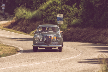 PESARO COLLE SAN BARTOLO, ITALY - MAY 17 - 2018: LAUNCHES AURELIA B 20 GT 2500 1957 on an old racing car in the Mille Miglia rally 2018 the famous italian historical race (1927-1957)